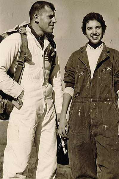 Vintage photo of a young Stephanie Wolf Hughes in a flight suit with unidentified flight instructor.