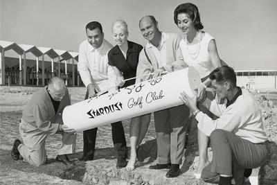 Tommy McDonald, Merv Adelson, Gaby Whitaker, Irwin Molasky, Valda Boyne Esau, and Howard Capps burying a time capsule.