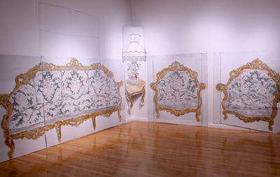 Installation view of Ramiro Gomez's artwork made out of cardboard and paint