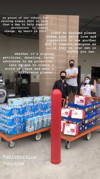 UNLV nursing students who are part of the Student Nurses Association stand with donations for peaceful protesters