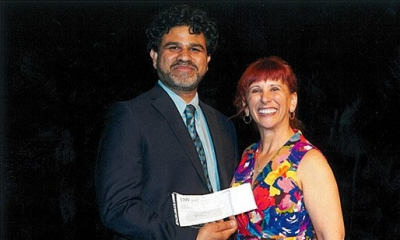 Haroon Stephen receives award.