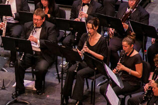 3 orchestral performers on a stage
