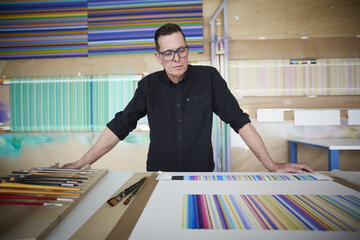 Tim Bavington poses in his studio