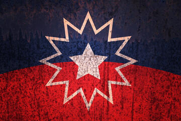 The Juneteenth flag, concentric white stars on a field of red and blue