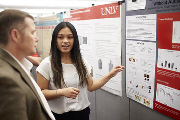 woman presenting at research symposium