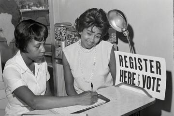 Two women look over paperwork