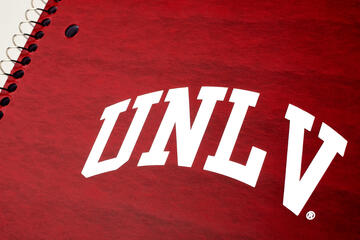 red notebook with white arched UNLV logo