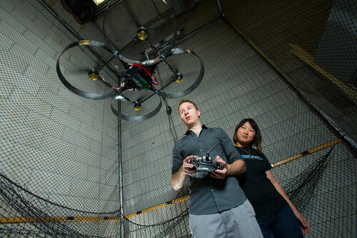 Two students testing an aerial drone