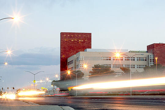 Traffic speeds past Greenspun Hall on Maryland Parkway