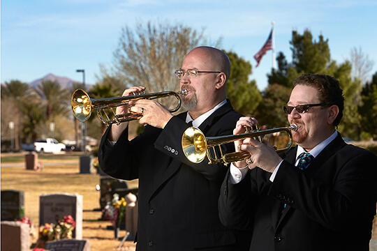 Gary Cordell and Larry Ransom play trumpet at a funeral