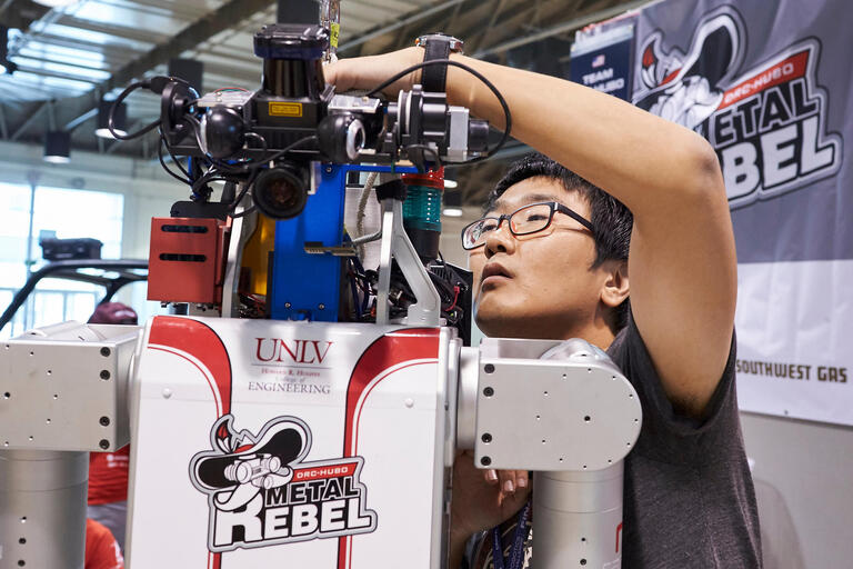 Kiwon Sohn makes a few adjustments to Metal Rebel before the start of the DARPA Robotics Challenge Finals.