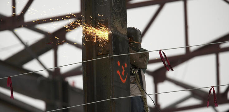 Man welding up on a pole