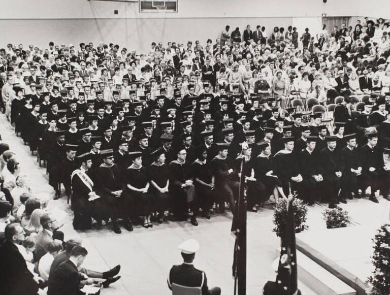 Students wait to receive their diplomas