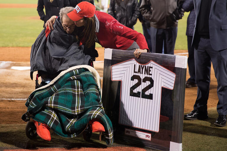 man in wheelchair receiving honorary jersey