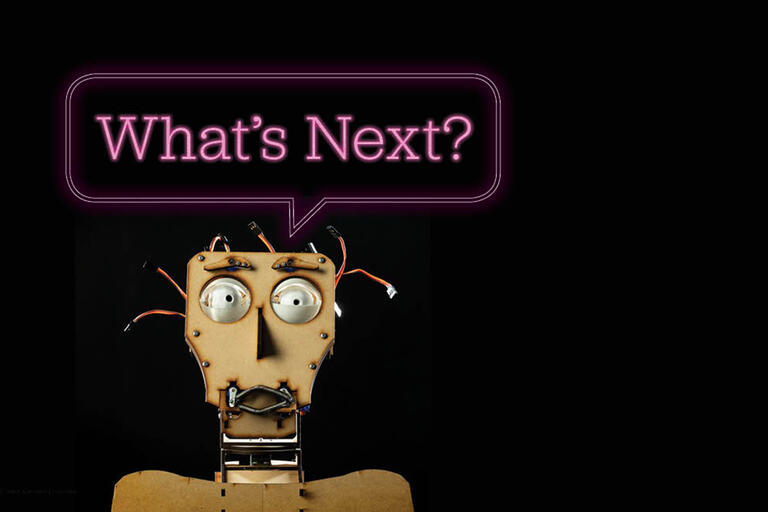 "animatronic character asking ""What's Next?"""