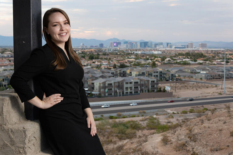 A woman stands overlooking the Las Vegas Strip