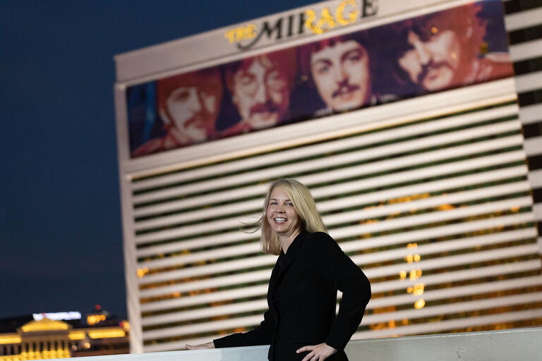Woman poses in front of the Mirage casino
