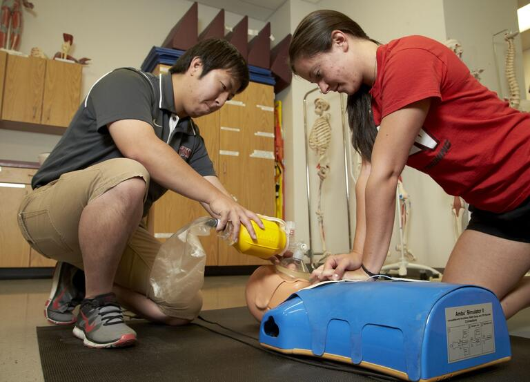 two people doing CPR training