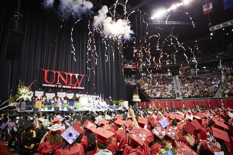 UNLV students in caps and gowns celebrating commencement