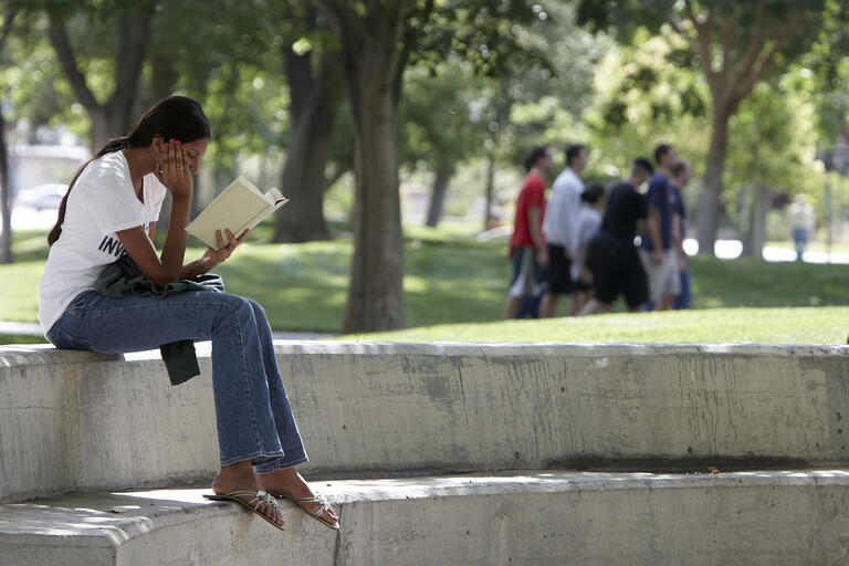 Student reads outside