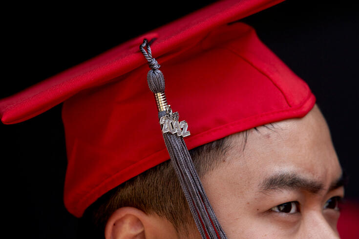 Close up side view of a graduate with a graduate hat on.