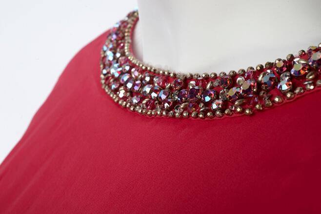 Top trim of a dress. Trim contains sparking rhinestones.