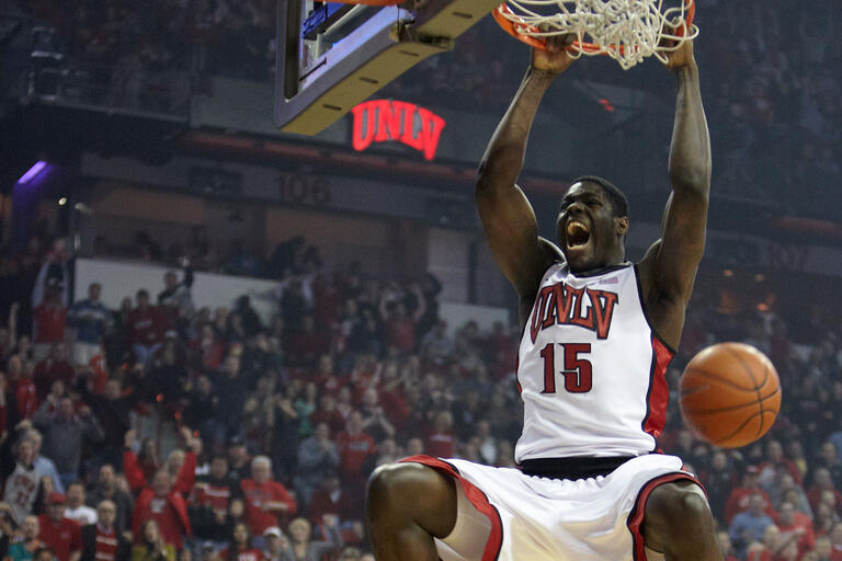 Anthony Bennett dunking a ball during a game.
