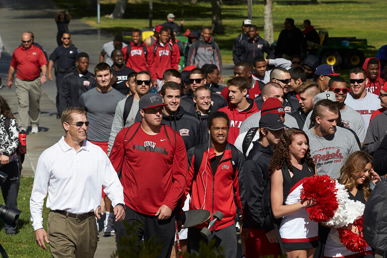 Group of student athletes walking together.