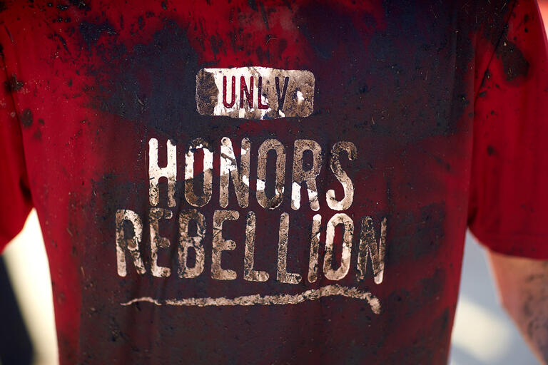 """Close up shot of the """"UNLV Honors Rebellion"""" t-shirt."""
