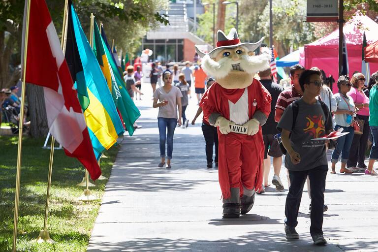 Hey Reb! mascot walk around the Festival of Communities