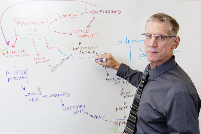 Dr. Stephen Dahlem draws on white board