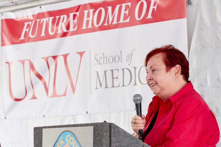 Dr. Barbara Atkinson speaks at podium