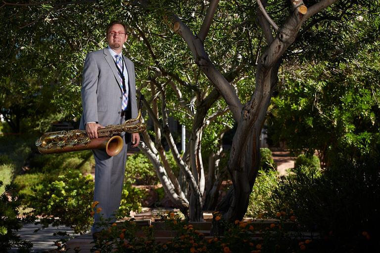 Adam Schroeder holding saxophone