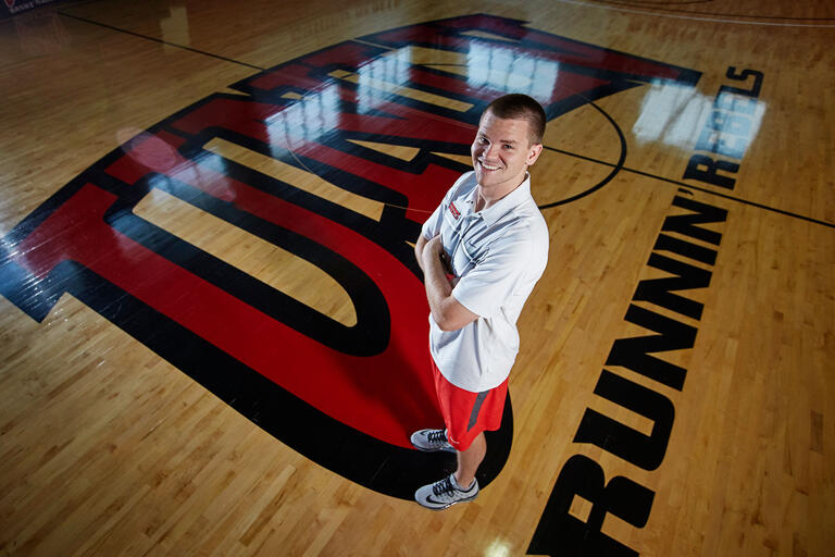 Preston Laird poses on basketball court