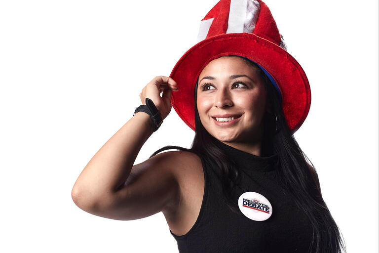Jennifer Hurtado with a red and white stripped tophat