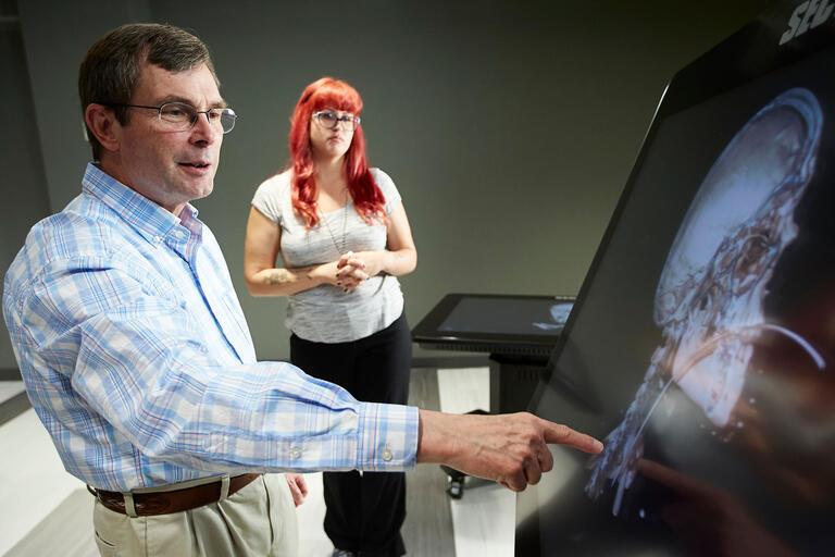 Jeff Fahl examines an x-ray