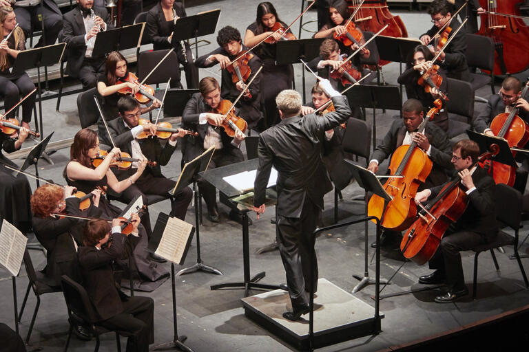 A conductor leads an orchestra.