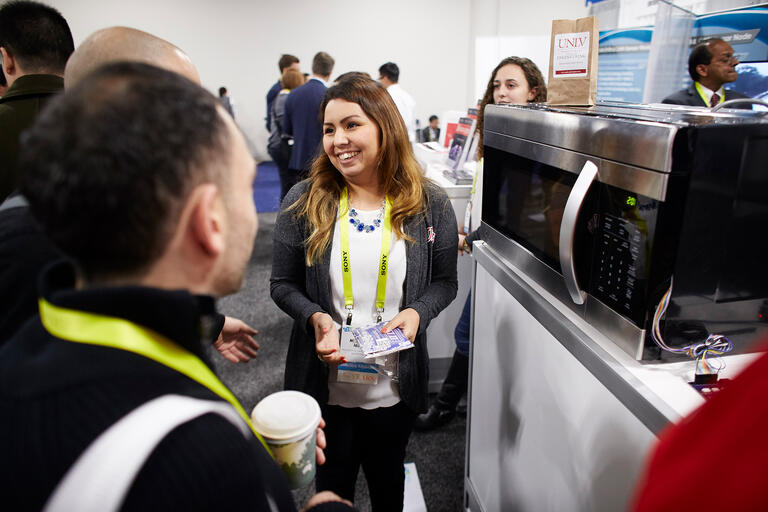 Student Michelle Mata works at a Consumer Electronics Show booth