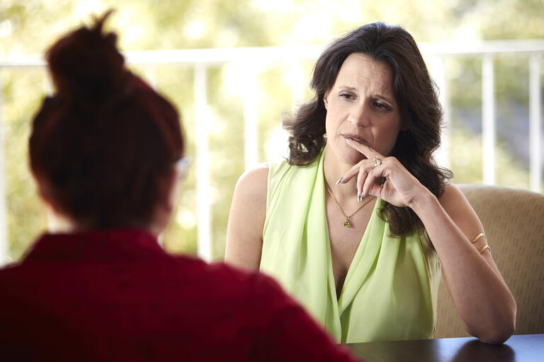 Katherine Hertlein counsels a patient.