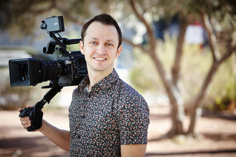 portrait of man holding video equipment