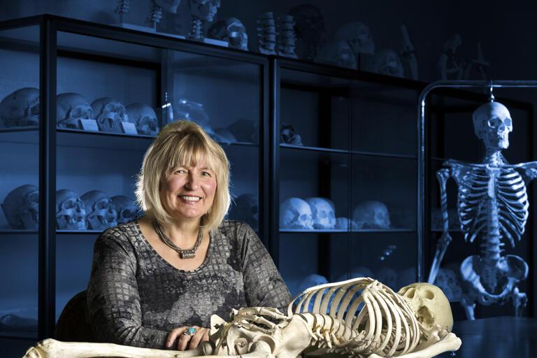 Portrait of anthropology professor Debra Martin a classroom.