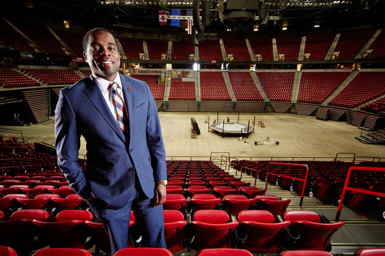 Marcus Bowman with the inside of the Thomas and Mack Arena behind him.