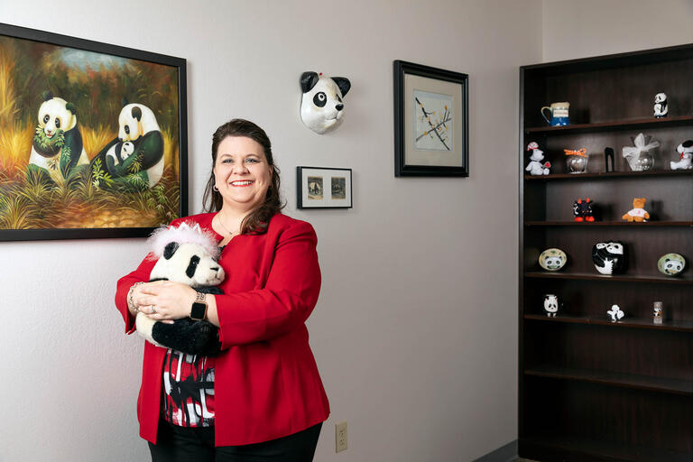 Lori Ciccone, the executive director of the office of sponsored programs, poses in her office.