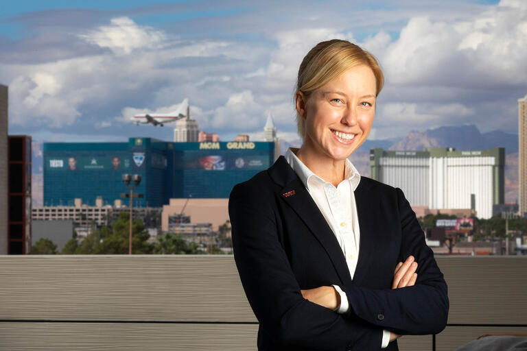"Katheryn ""K.C."" Brekken, Assistant Research Professor for the School of Public Policy and Leadership and MGM Resorts International Institute at UNLV poses in front of the Las Vegas Strip."