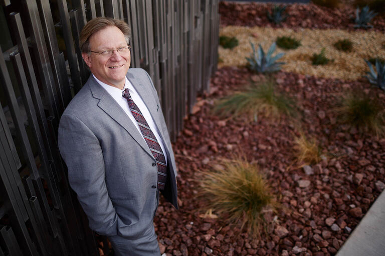 Tim Durnford poses in front of UNLV's Hospitality College.