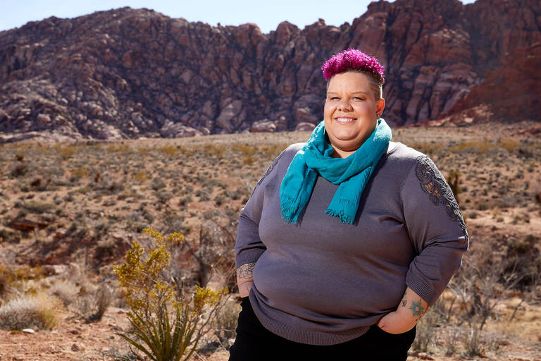 Ashlyn Gray poses in front of Calico Basin in Red Rock