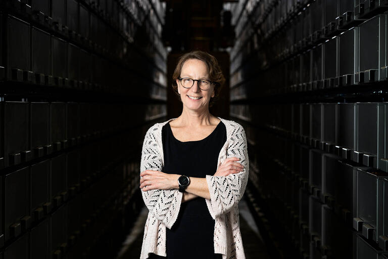 Kristen Costello poses in front the of the Lied Library Automated Storage and Retrieval System.