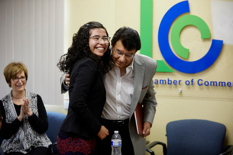 A man and woman embrace at the Latinx/UNLV meeting.