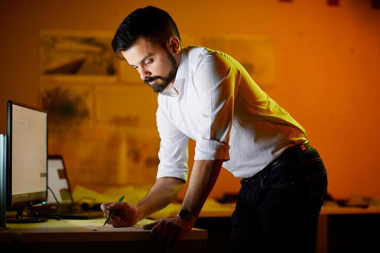Dominic A. Armendariz working at his computer.