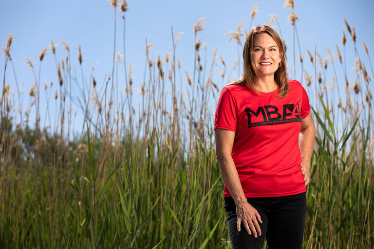 Lisa Davis standing in tall grass at the Wetlands.